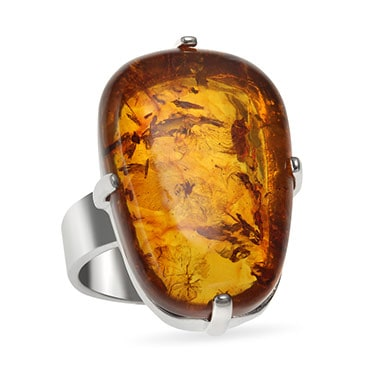 Amber ring with silver band on a white background.