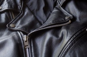 Apply a water and stain protector to your leather jacket to...