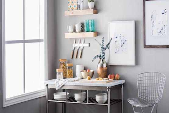 Kitchen counter with floating shelves hung on the wall.