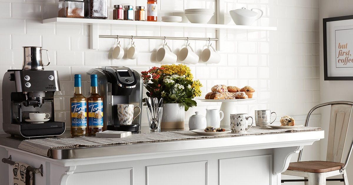 Coffee Bar: How to Be Your Own Barista - Overstock.com on kitchen library ideas, kitchen coffee bar ideas, kitchen island ideas, porch area ideas, small kitchen remodeling ideas, kitchen with barn wood on ceiling, kitchen bar surface ideas, kitchen bar countertop ideas, kitchen breakfast room ideas, for small kitchens kitchen ideas, kitchen half bath ideas, fireplace area ideas, kitchen design with stone and wood, stereo area ideas, small kitchen cabinet paint color ideas, kitchen fridge ideas, kitchen bar color ideas, kitchen bar light ideas, kitchen eating bar ideas,